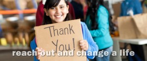 Girl holding Thank You sign. Caption reads Reach Out and Change a Life.